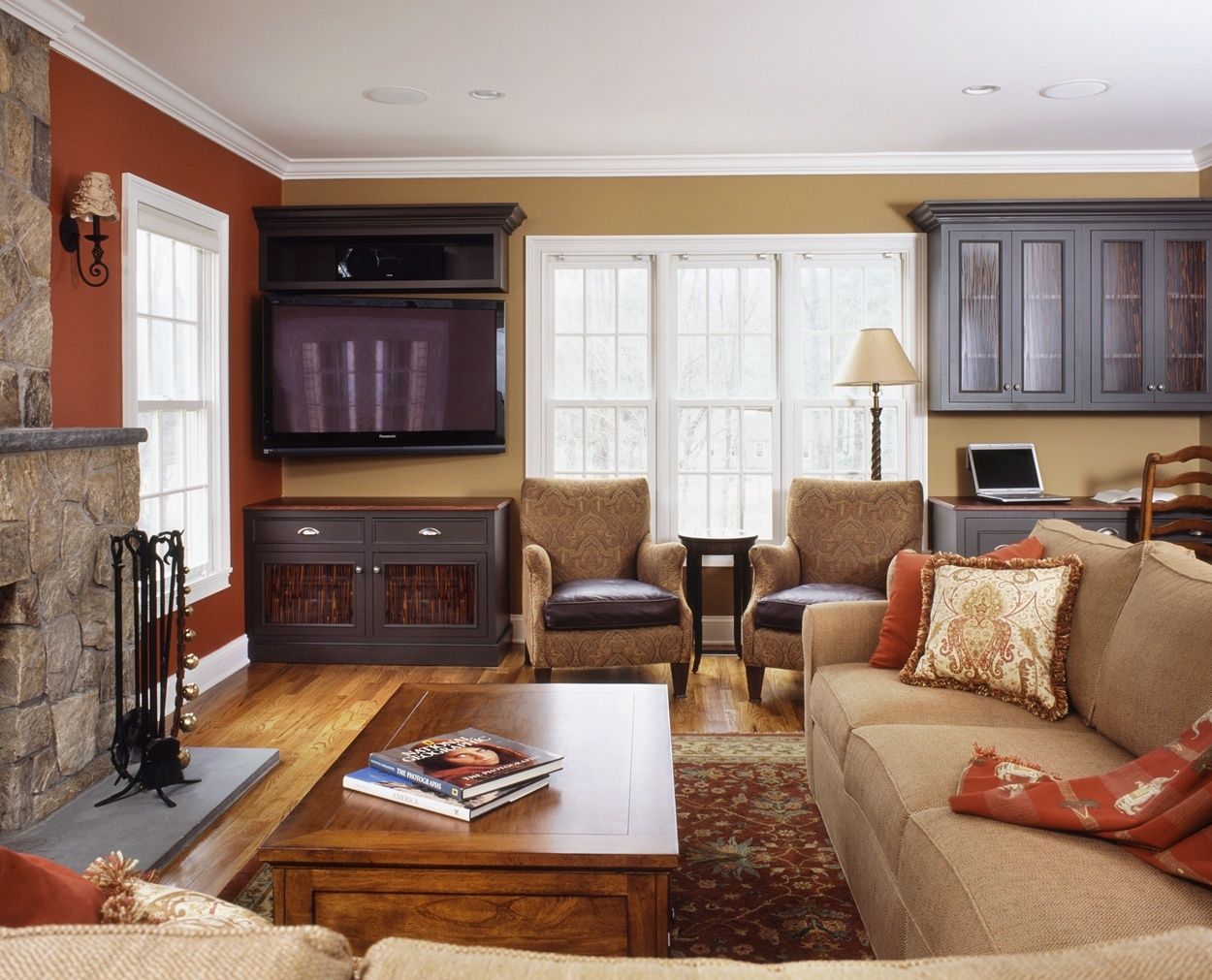 Dark builtins provide storage in this Ridgefield great room.