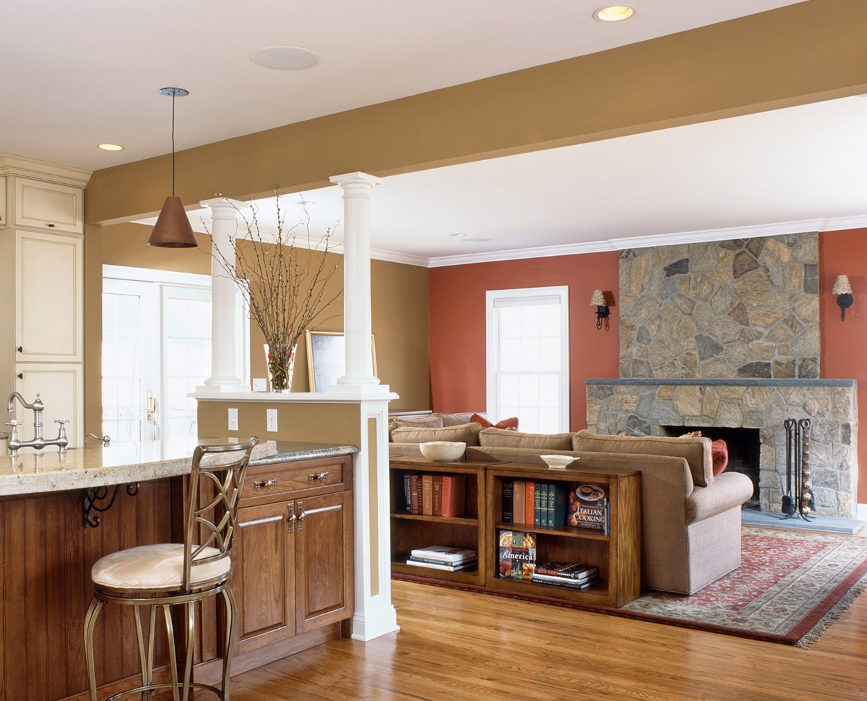 View from the kitchen to the livingroom towards the stone veneer fireplace.