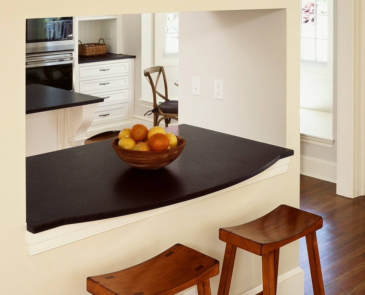 Honed absolute black granite counter passthrough