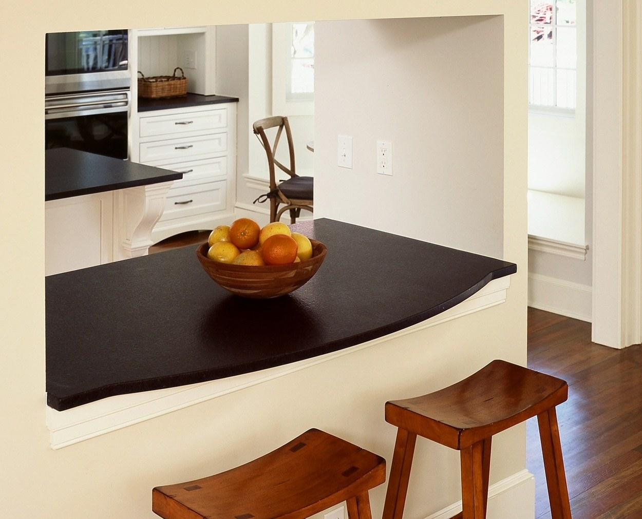 Honed absolute black granite counter passthrough
