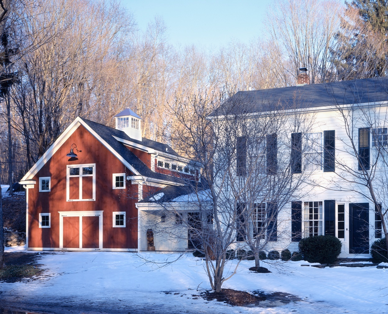 Wilton, CT colonial with new barn style garage with shed dormer.