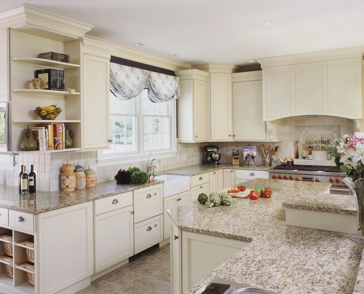 Creamy cabinets with a bi-level island and wrap around perimeter.