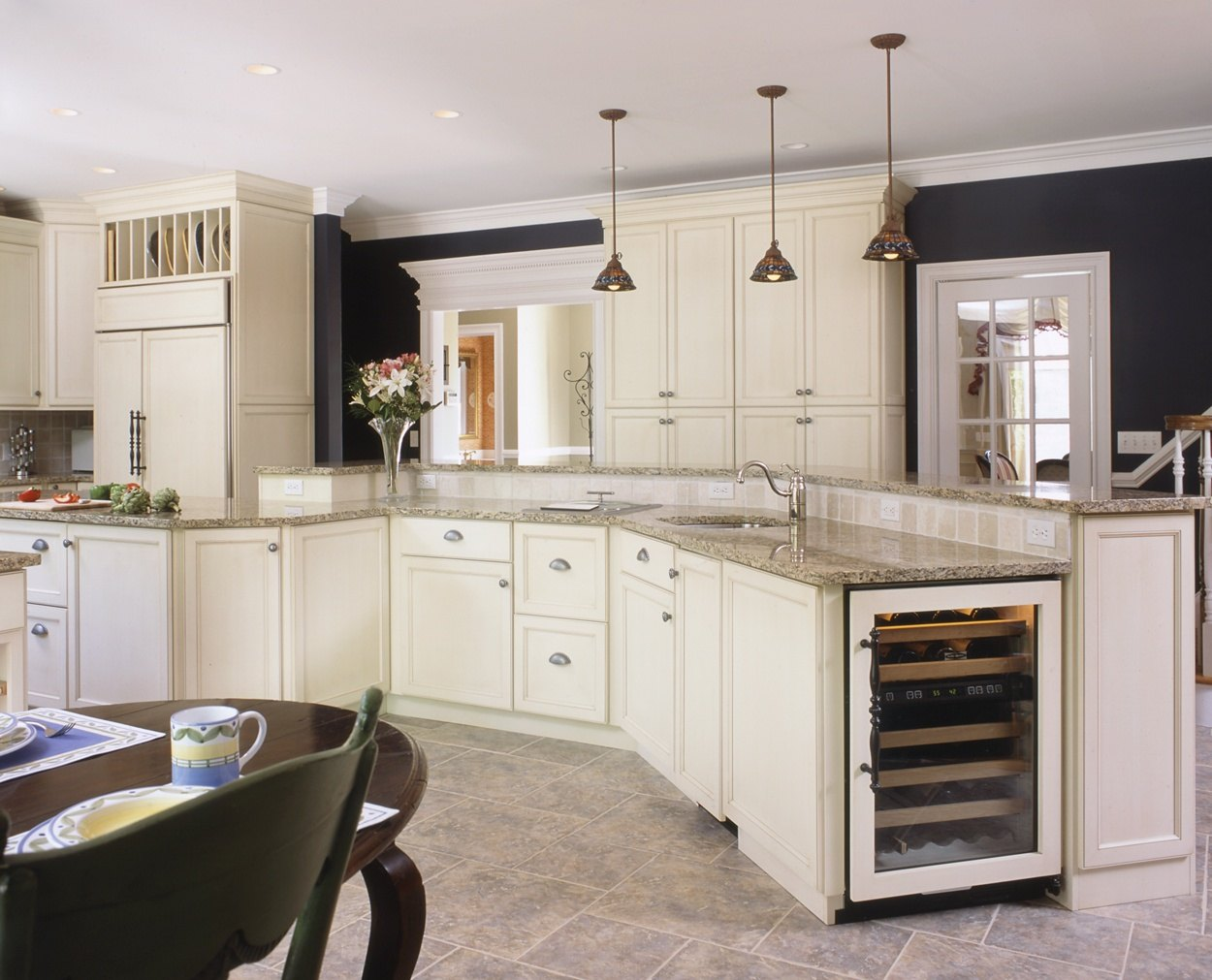 A kitchen for entertaining with a large bi-level island designed by Clark Construction.