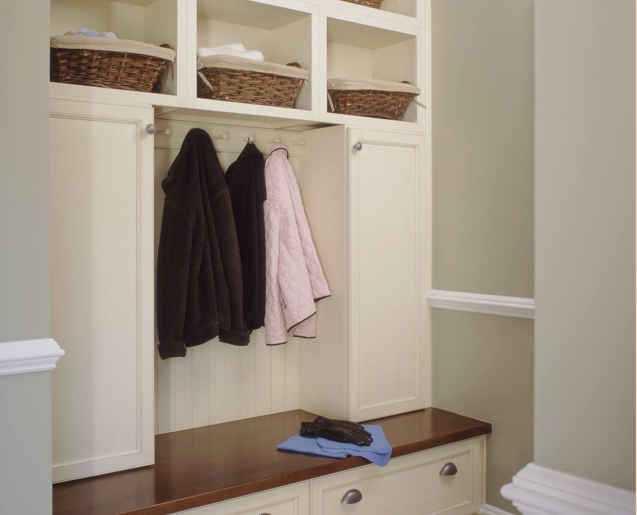 hooks and baskets and a solid wood top are the hightlight of this mudroom builtin.