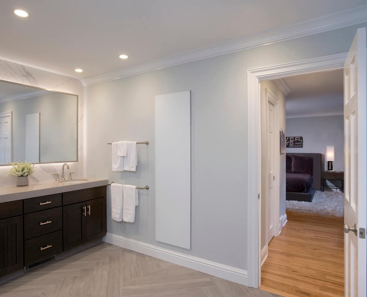 master bedroom can be seen through the door of this well designed master bedroom suite