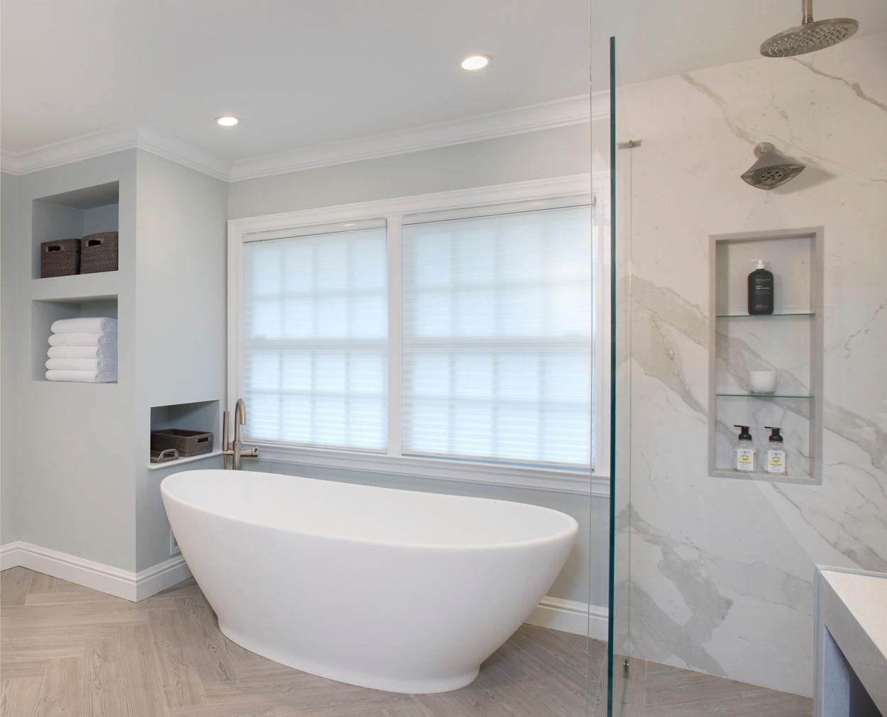 free standing tub, with white towels and Crate and Barrel baskets in a storage unit