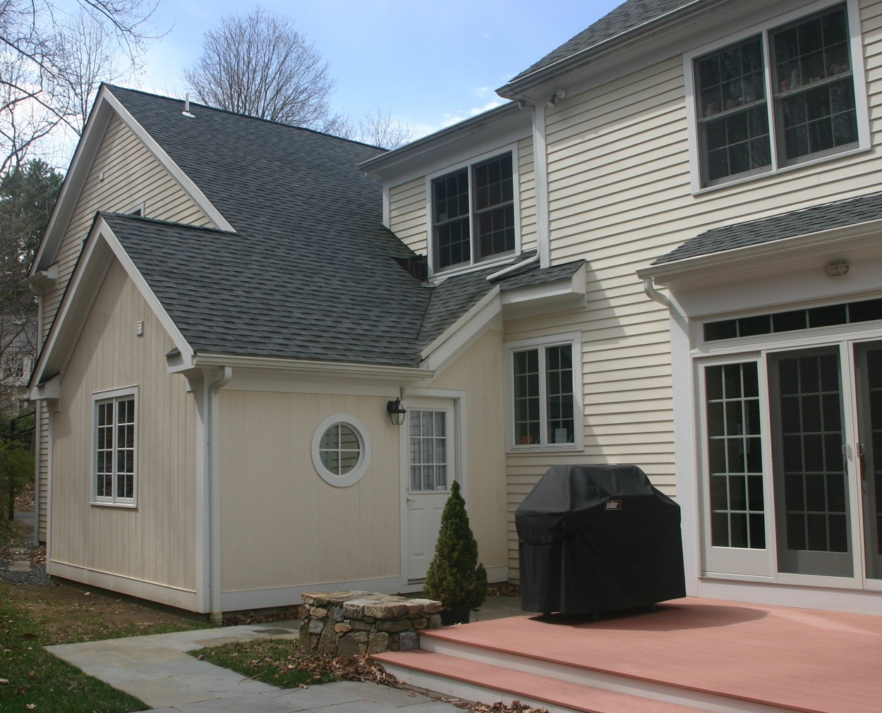 New garage bay blends into existing home.