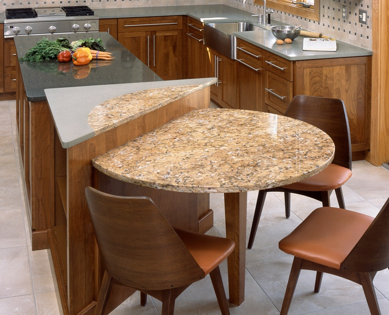 Two level island with a circle detail that goes from one level to the other by Clark Construction's lead designer.