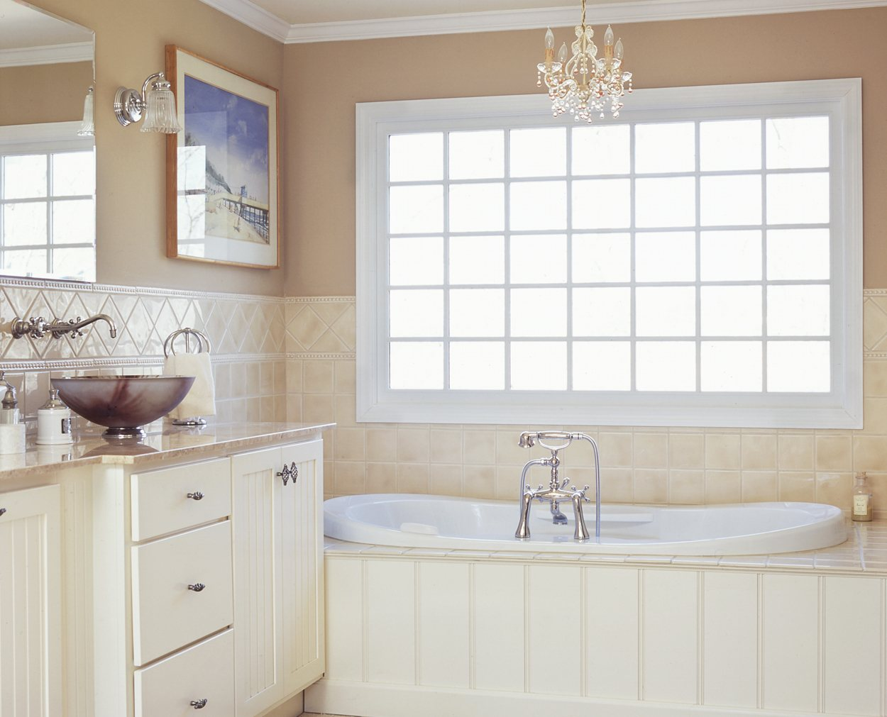 Beadboard tub front, with shake white cabinets and vessel sinks in Clark Construction bath renovation.