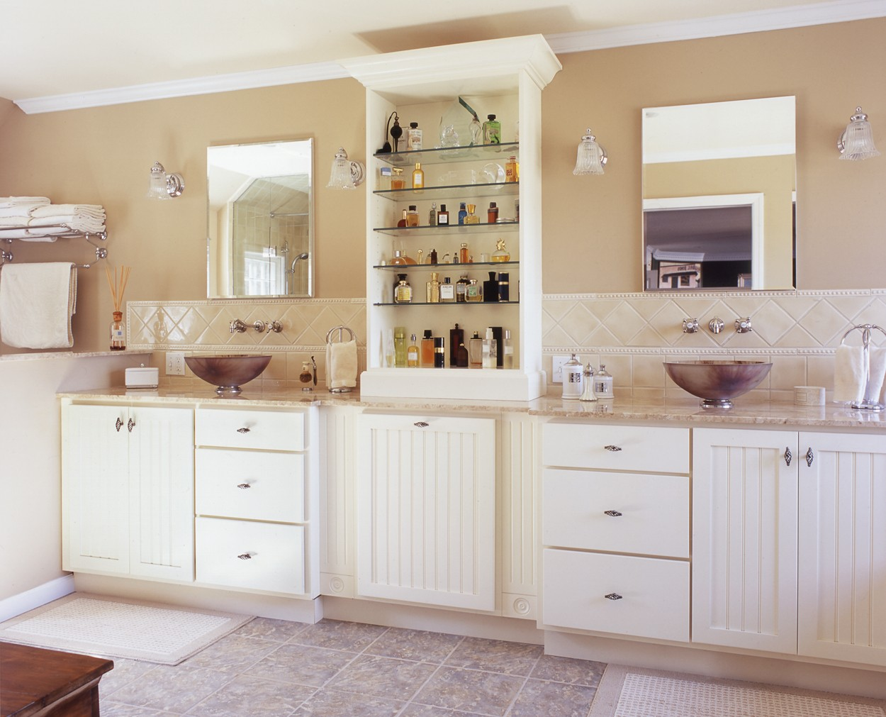 Nantucket style vanities with tower between them, in Clark Construction Wilton CT bath remodel.
