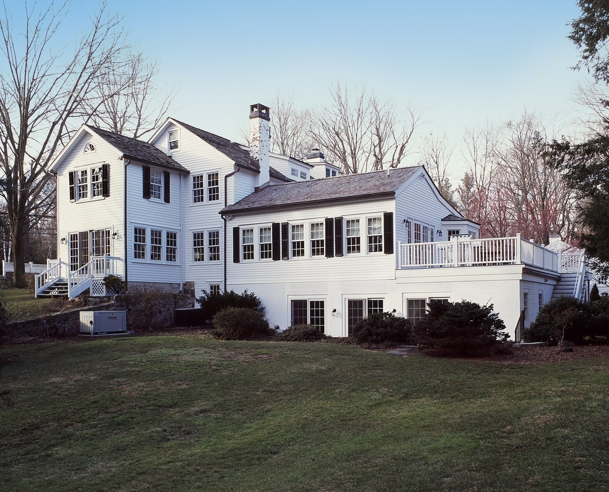 New Canaan 1850s home has indoor pool filled in and converted to living space.